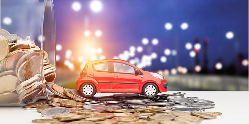 little red car on a pile of coins from an auto loan