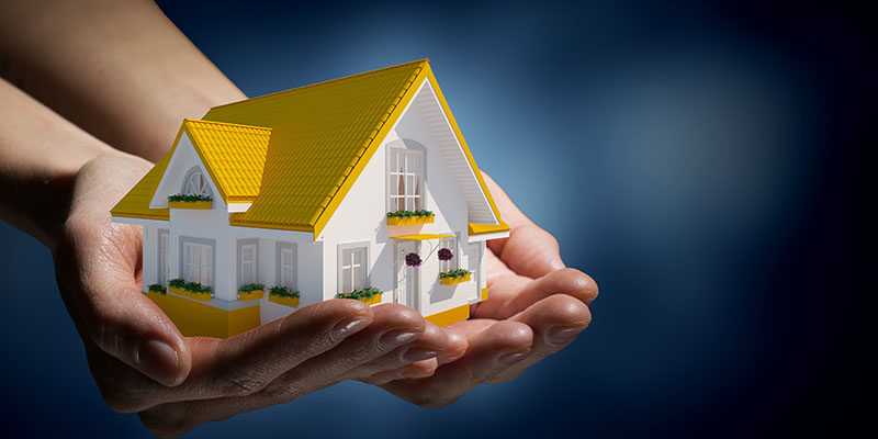 lender holding a model of a house