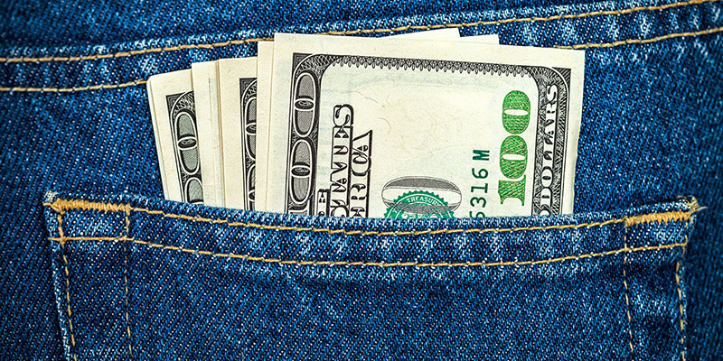 money in jeans pocket from a personal loan